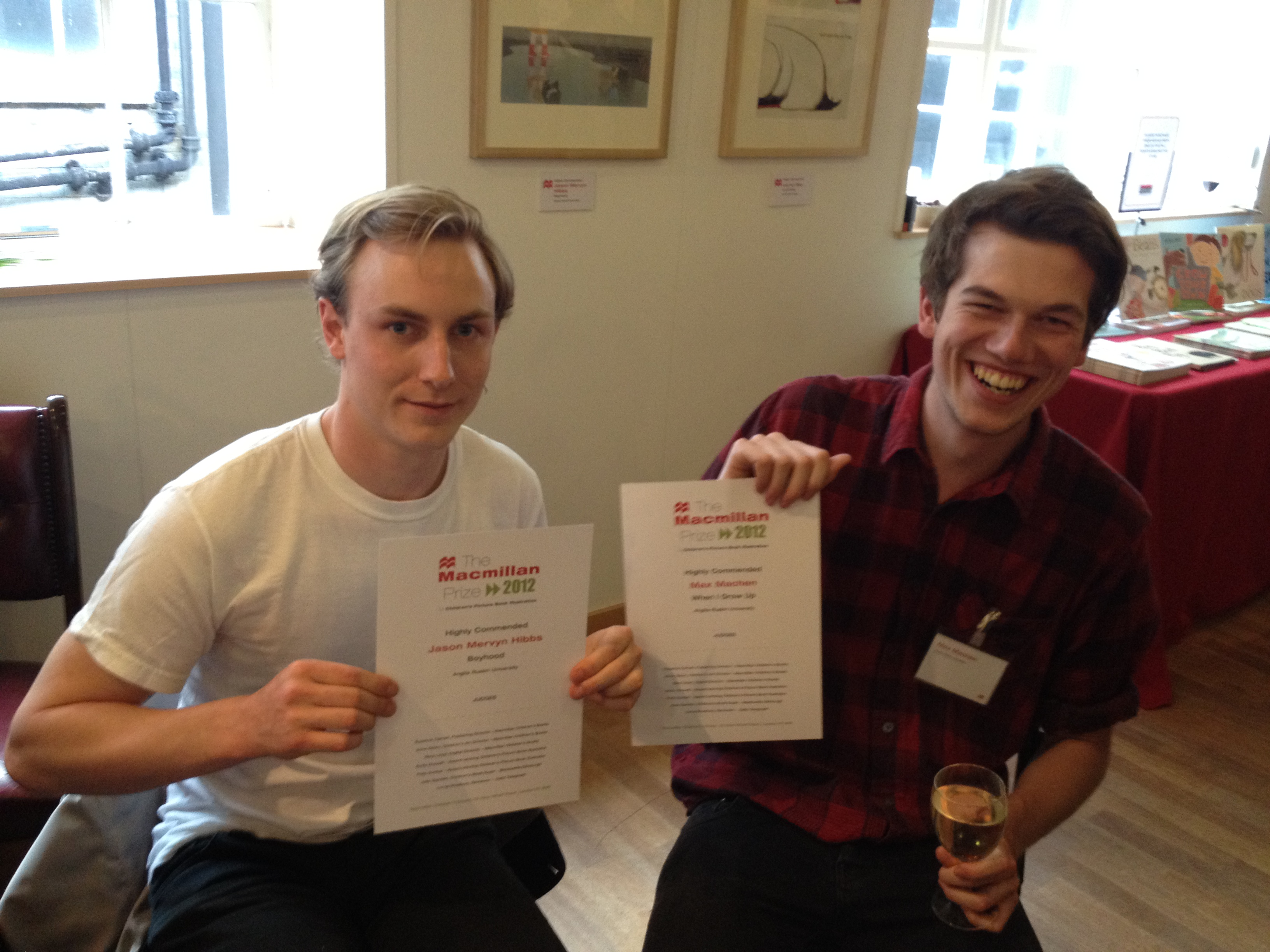 iPhone photograph of Jason Hibbs and Max Machen holding their Highly Commended certificates from The Macmillan Prize 2012